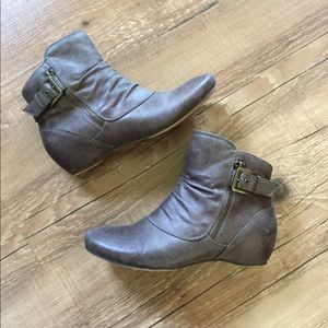 Brown zipper and buckle ankle boots
